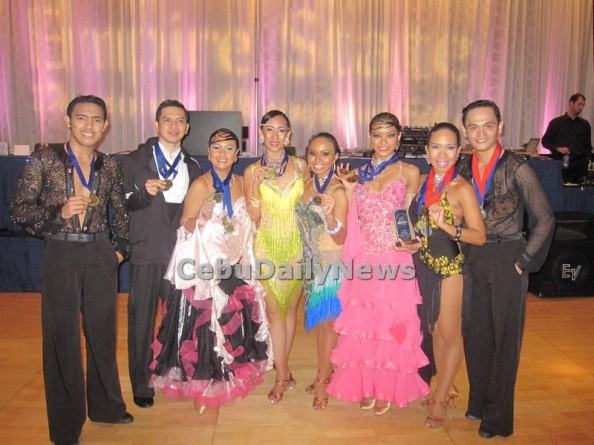 Members of Cebu City Dancesport Team with Eleonor Hayco (fourth from left) show their gold medals after winning the Empire State Dancesport Competition in New York City./ Contributed Photo